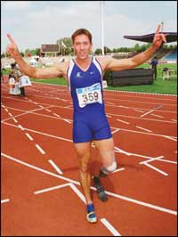 Brian Frasure celebrates after winning a gold medal in the T-44 200m sprint.