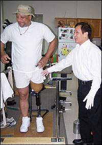 Joe Williams and Tien Tran, CP, FAAOP, on his first day of fitting and prosthetic training.