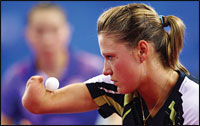 Natalia Partyka competes in the women's team table tennis event of the Beijing 2008 Olympics.  Photograph by Alexander Hassenstein/Bongarts/Getty Images.