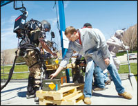 Raytheon Sarcos employees try to keep up with software engineer Rex Jameson as he uses the exoskeleton to load a pallet during a demonstration. Photographs courtesy of Raytheon.