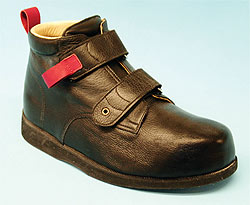 Chukka boot with pull loops, shown in red for emphasis, and grommet.
