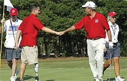 Fain shaking hands with former President George W. Bush