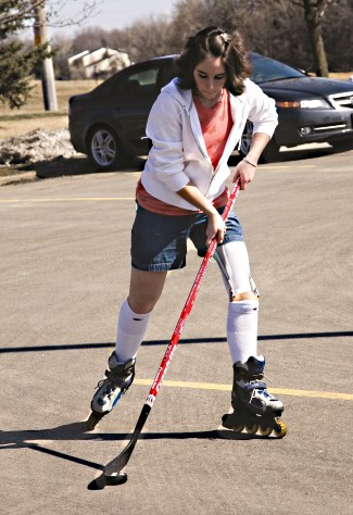 Decker plays street hockey