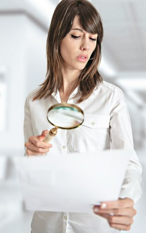 clinician with magnifying glass