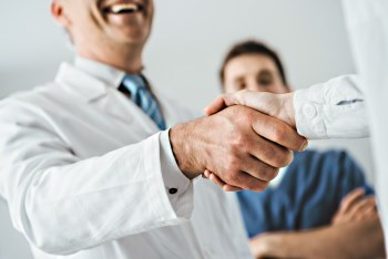 clinician shaking hands with patient